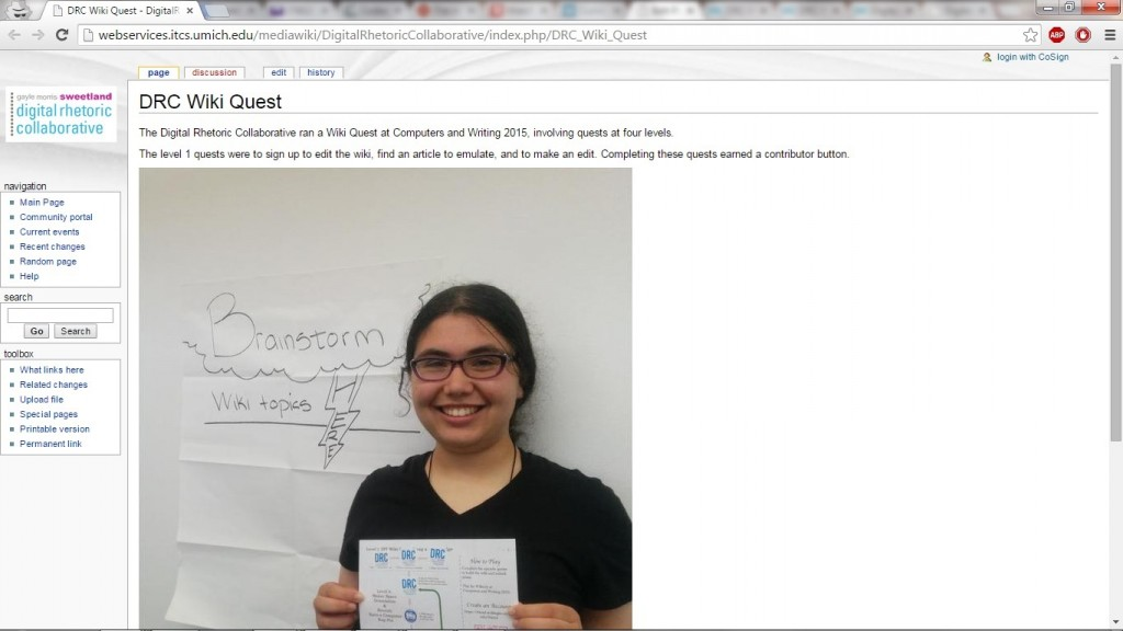 DRC Wiki Quest Wiki Page: Featuring Alyssa Hillary's Text Describing the DRC Wiki Quest and a Photo of Alyssa Hillary and the DRC Wiki Quest Game Sheet