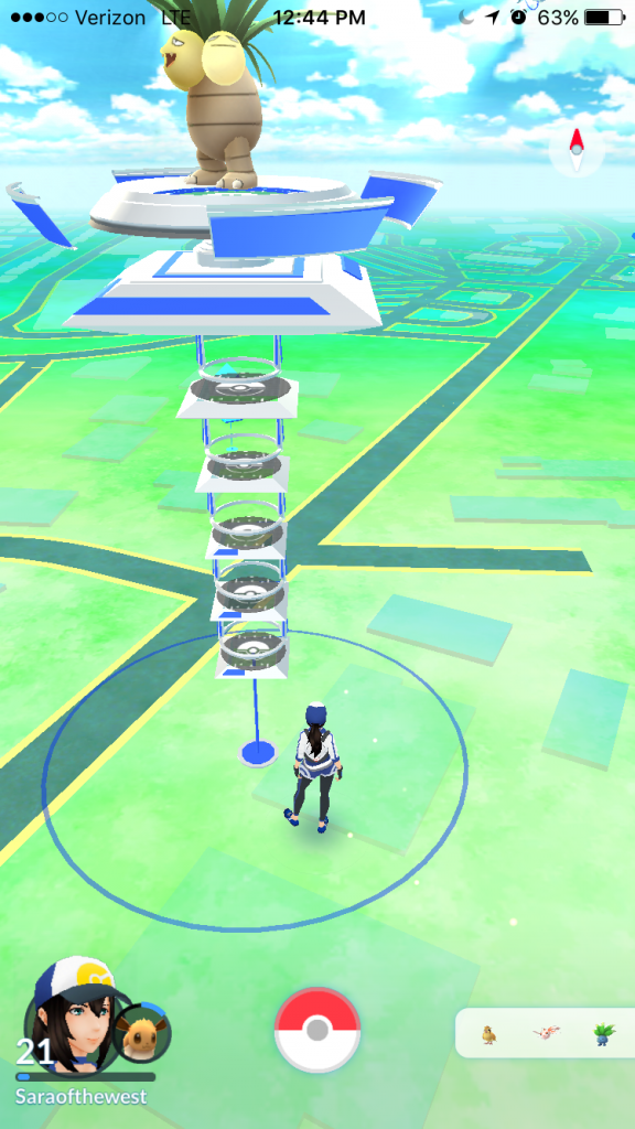 Virtual player on the game map. Large blue/silver structure is a Team Mystic controlled grym. Smaller blue boxes (across the road) indicate Pokéstops. Right-hand icon displays player avatar and level; left-hand menu displays recently sighted Pokémon in the area.