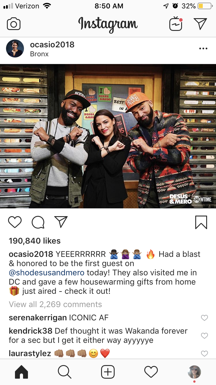 A screenshot of an Instagram post of AOC standing in the middle of Desus and Mero, Shotime hosts from the Bronx. All three are making an X symbol across their chests with their arms.