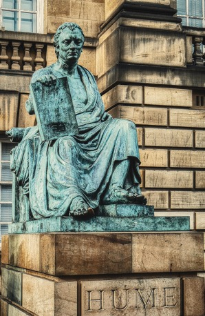 Photo shows a statue of the philosopher David Hume in Edinburgh, UK